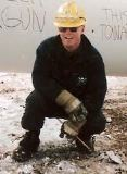 Political Prisoner Brad Love at work in the oilpatch